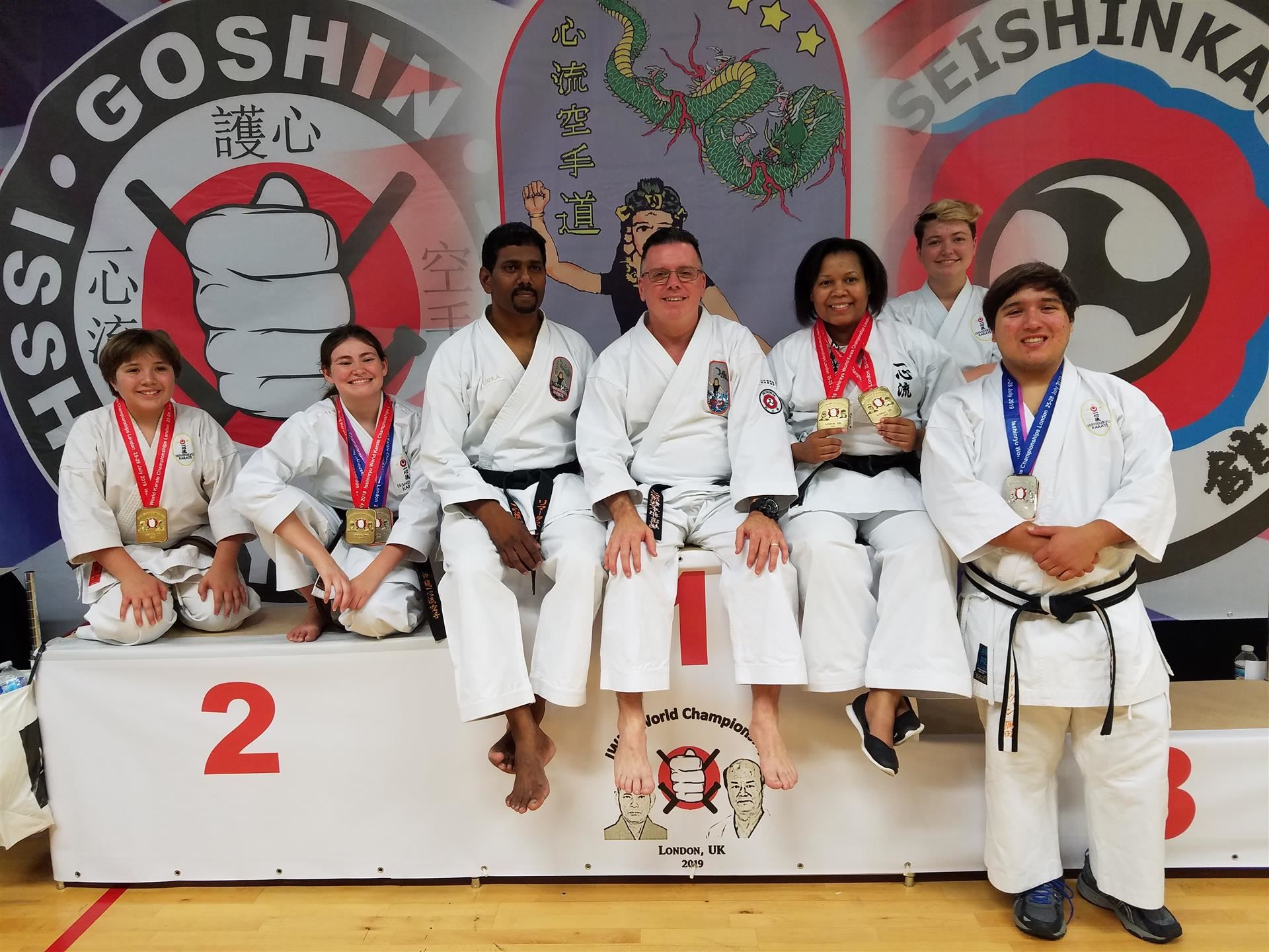Karate champions on podium with medals
